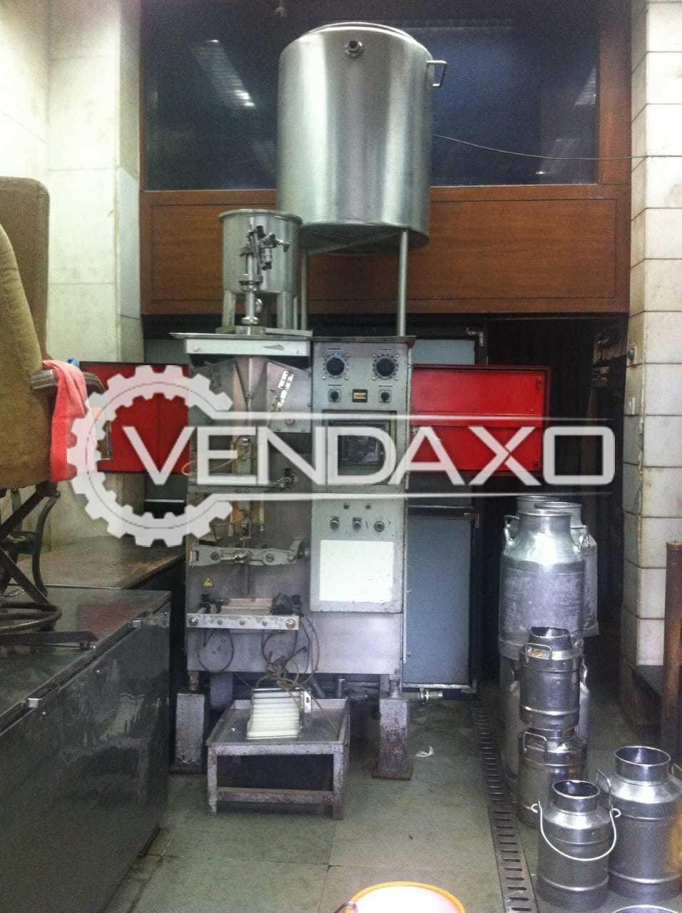 Fully Auto Nichrome Filpack 1200 Packaging Machine to Fill Milk - 200 ML / Oil - 500 ML / Liquids - 1000 ML Per Hour